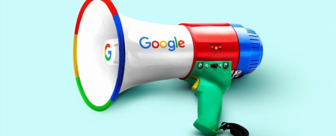 White megaphone emblazoned with Google's logo laying on a light blue background